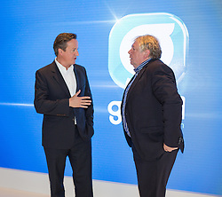 © Licensed to London News Pictures . 30/09/2014 . Birmingham , UK . David Cameron after being interviewed at the LBC stand this morning with with Nick Ferrari . The 2014 Conservative Party Conference in Birmingham . Photo credit : Joel Goodman/LNP