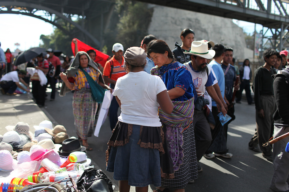 A woman sells hats to the members of the march. After 9 days and 212 kilometers, the Indigenous, Campesino and Popular March for the defense of Mother Earth, against evictions, criminalization, and in favor of Integrated Rural Development, arrived to the Capital City. According to members of the Committee for Campesino Unity (CUC), it is estimated that about 15,000 people participated in the ninth and final day of the march.
