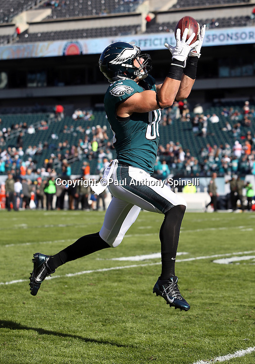 Philadelphia Eagles tight end Zach Ertz (86) leaps and catches a pregame pass while warming up before the 2015 week 10 regular season NFL football game against the Miami Dolphins on Sunday, Nov. 15, 2015 in Philadelphia. The Dolphins won the game 20-19. (©Paul Anthony Spinelli)