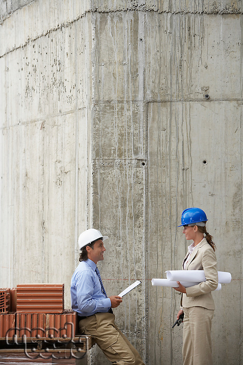 Construction manager and architect talking on site