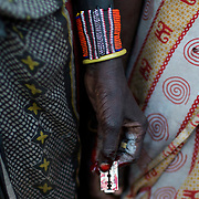 A Pokot woman holds a razor blade after performing a circumcision on four girls in a village about 80 kilometres from the town of Marigat in Baringo County, October 16, 2014.