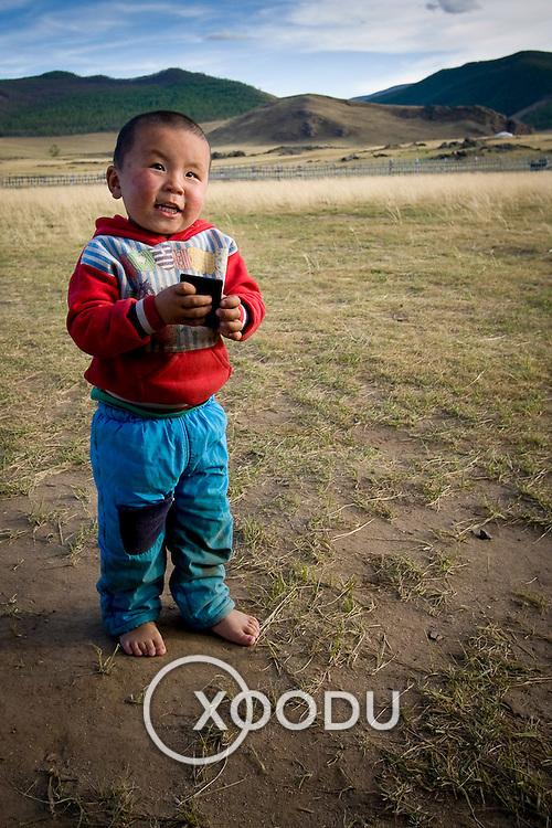 Young Mongolian boy playing (, Mongolia - Sep. 2008) (Image ID: 080909-1745092a)