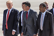 PRESIDENT DONALD J. TRUMP speaks with Nevada Governor BRIAN SANDOVAL and BEN CARSON on the tarmac after exiting Air Force One in Reno, Nevada, on Wednesday, August 23, 2017. <br /> <br /> Trump is speaking at the American Legion convention at the Reno-Sparks Convention Center. The American Legion is a war time veterans association that often holds its annual convention at the Reno-Sparks Convention Center.