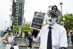 London, UK. 4 June, 2019. An activist disguised as Charlie Chaplin joins a protest by thousands of climate change activists, women's groups, students, pacifists, trade union members and families against the state visit of US President Donald Trump on the second day of his three day visit. A large policing operation was in place to facilitate the protest but to prevent access to areas immediately adjacent to Downing Street, where talks were taking place between Prime Minister Theresa May and President Trump.
