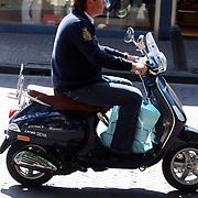 NLD/Laren/20070811 - John de Mol op zijn scooter