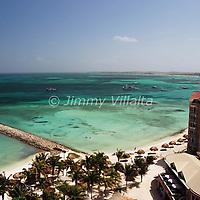 Aruba, is a 33km-long island of the Lesser Antilles in the southern Caribbean Sea, located 27km north of the coast of Venezuela. Together with Bonaire and Curaçao, it forms a group referred to as the ABC islands of the Leeward Antilles, the southern island chain of the Lesser Antilles.