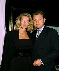MISS FIONA SLEEMAN and MR BERNARD DREESMAN at a party in London on 5th June 1997.LYZ 41
