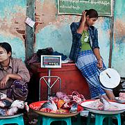 Myanmar (Burma). Bagan. Nyaung U market. Women selling fish.