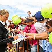 Victoria Azarenka signs larger than life sized tennis balls at the Indian Wells Tennis Garden in Indian Wells, California Friday, March 11, 2016.<br /> (Photo by Billie Weiss/BNP Paribas Open)