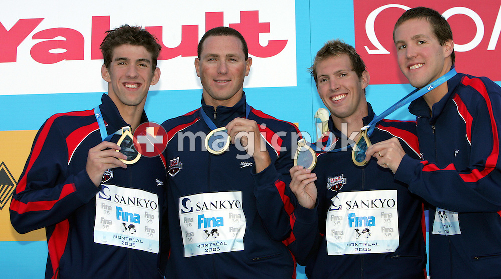 USA's team shows off his gold medal in the men's 4X100m Freestyle relay final the FINA World Championships in Montreal, Canada Sunday 24 July, 2005.  (Photo by Patrick B. Kraemer / MAGICPBK)