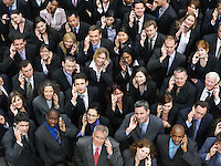 Large group of business people using mobile phones portrait elevated view