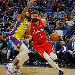 Feb 14, 2018; New Orleans, LA, USA; New Orleans Pelicans forward Nikola Mirotic (3) drives past Los Angeles Lakers forward Brandon Ingram (14) during the second half at the Smoothie King Center. The Pelicans defeated the Lakers 139-117. Mandatory Credit: Derick E. Hingle-USA TODAY Sports