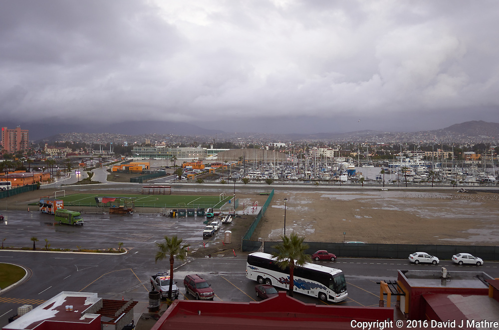 "(Image four of nine) Panorama of the Ensenada harbor in Mexico on a grey and raining day from the deck of the MV World Odyssey. The other cruse ship is the Carnival Imagination. Once all of the students, faculty, staff, and life long learners were aboard we would be ready to begin the 102 day ""round the world"" Semester at Sea Spring 2016 Voyage. Composite of nine images taken with a Leica T camera and 23 mm f/2 lens (ISO 250, 23 mm, f/2, 1/80 sec). Panorama stitched using AutoPano Giga Pro."