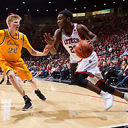 31 January 2017:  The San Diego State Aztecs men's basketball team hosts Wyoming Tuesday night at Viejas Arena. San Diego State guard Montaque Gill-Caesar (23) drives to the basket while being defended by Wyoming forward Hayden Dalton (20) in the second half. The Aztecs beat the Cowboys 77-68 at half time. www.sdsuaztecphotos.com