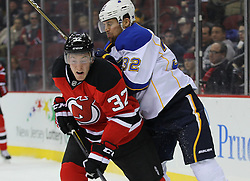 Feb 9; Newark, NJ, USA; St. Louis Blues left wing Chris Porter (32) hits New Jersey Devils defenseman Matt Taormina (32) during the first period at the Prudential Center.