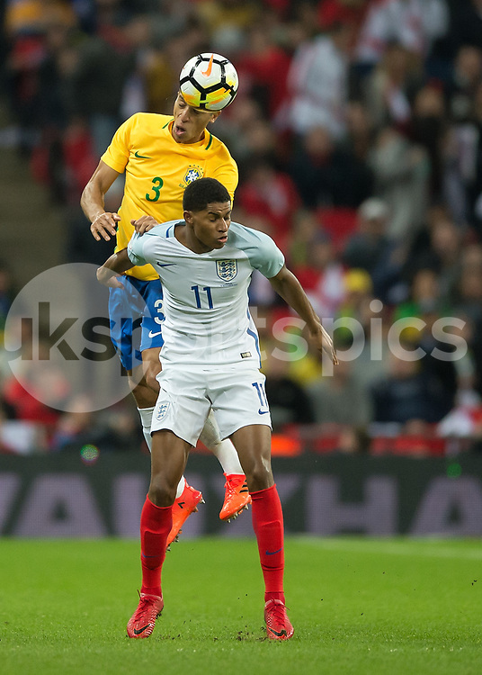 Miranda of Brazil heads the ball clear from Marcus Rashford of England during the International Friendly match between England and Brazil at Wembley Stadium, London, England on 14 November 2017. Photo by Vince Mignott.