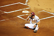 Jul. 15 2011; Phoenix, AZ, USA; Arizona Diamondbacks baserunner Willie Bloomquist (18) reacts at home plate after being thrown out at home during the first inning against the Los Angeles Dodgers at Chase Field. Mandatory Credit: Jennifer Stewart-US PRESSWIRE