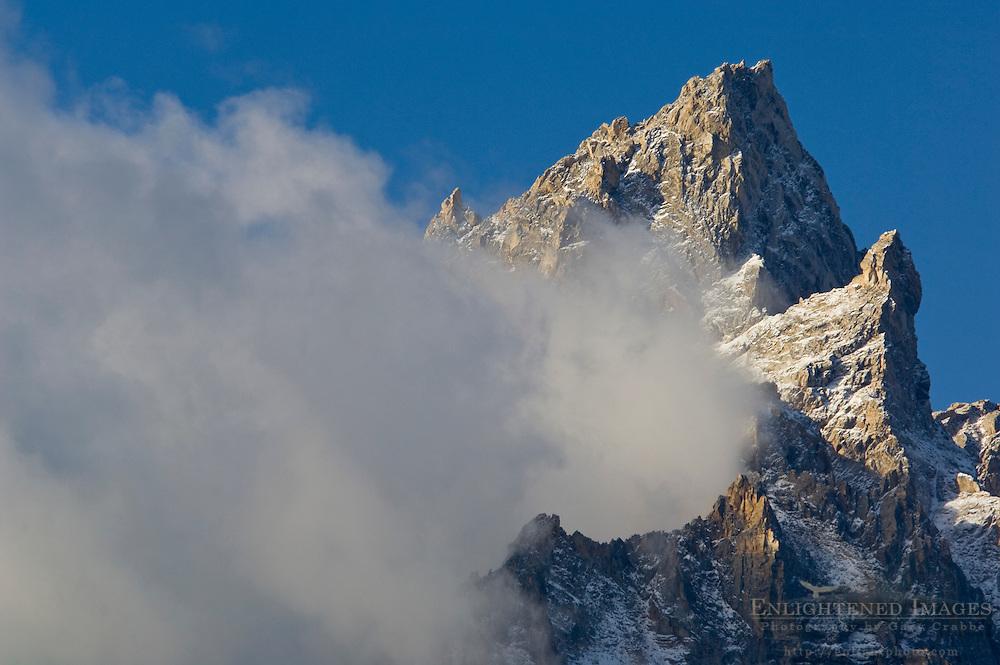 Cloud streaming off Teewinot mountain peak, Grand Teton National Park, Wyoming