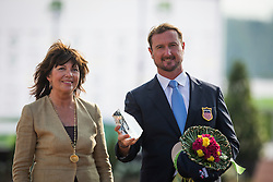 Chester Weber, (USA), Carola Vetter, (GER), handing over the In memriam Dr. Franz Vetter Trophee - Driving dressage day 2 - Alltech FEI World Equestrian Games™ 2014 - Normandy, France.<br /> © Hippo Foto Team - Dirk Caremans<br /> 05/09/14