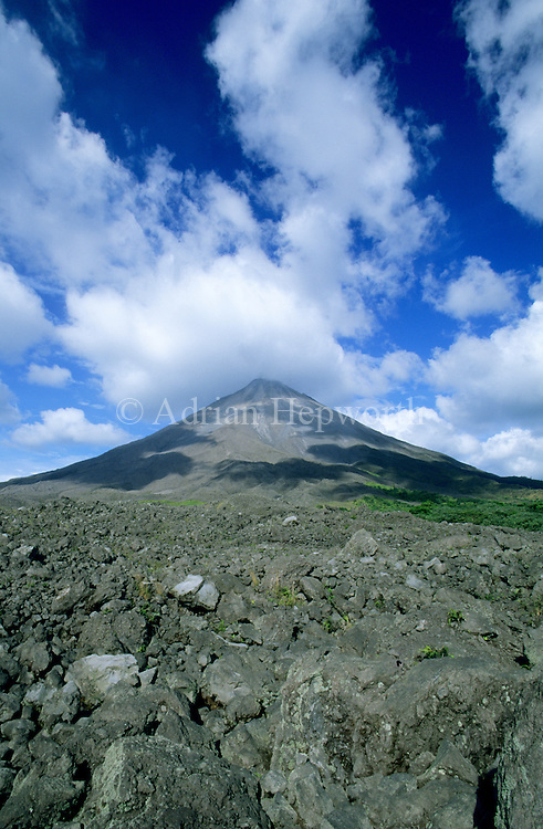 Arenal Volcano with old lava flow from 1992 in foreground. Costa Rica.<br /> <br /> For pricing click on ADD TO CART (above). We accept payments via PayPal.