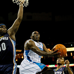 December 21, 2011; New Orleans, LA, USA; New Orleans Hornets small forward Quincy Pondexter (20) shoots between Memphis Grizzlies small forward Rudy Gay (22) and power forward Zach Randolph (50) during the first quarter of a game at the New Orleans Arena.   Mandatory Credit: Derick E. Hingle-US PRESSWIRE