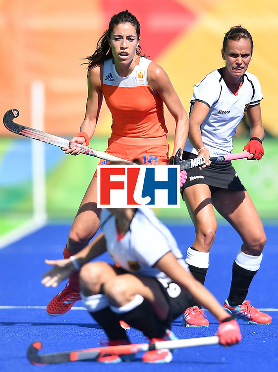 Netherlands' Naomi As van and Germany's Jana Teschke (R) vie during the women's field hockey Netherlands vs Germany match of the Rio 2016 Olympics Games at the Olympic Hockey Centre in Rio de Janeiro on August, 13 2016. / AFP / MANAN VATSYAYANA        (Photo credit should read MANAN VATSYAYANA/AFP/Getty Images)