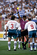 FIFA World Cup - USA 1994<br /> 26.6.1994, Soldier Field Stadium, Chicago, Illinois.<br /> Group D, Bulgaria v Greece.<br /> Referee Ali Mohamed Bujsaim (UAE) shows the yellow card to Trifon Ivanov (Bulgaria).