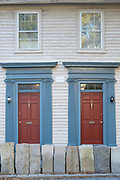 Wooden clapboard period houses with elegant front door and porch and stone barrier on Benefit Street in Providence, Rhode Island, USA