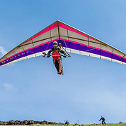 Ken Cavanaugh launching his hang glider into the wind
