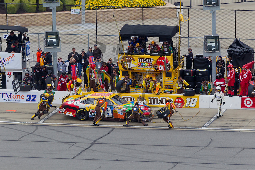 KANSAS CITY, KS - APR 22, 2012:  Kyle Busch (18) races during the STP 400 at the Kansas Speedway in Kansas City, KS.