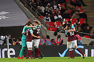 Angelo Ogbonna of West Ham United celebrates with his teammates after he scores his team's third goal. EFL Carabao Cup, 4th round match, Tottenham Hotspur v West Ham United at Wembley Stadium in London on Wednesday 25th October 2017.<br /> pic by Steffan Bowen, Andrew Orchard sports photography.