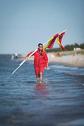 THEMENBILD - Deutsche Lebens-Rettungs-Gesellschaft ist eine gemeinn&uuml;tzige und selbstst&auml;ndige Wasserrettungs- und Nothilfeorganisation. Sie arbeitet grunds&auml;tzlich ehrenamtlich mit freiwilligen Helfern. Mit knapp &uuml;ber 550.000 Mitgliedern, Aufgenommen am 9. Juni 2015 in Prerow. Hier im Bild Carsten Rosenberg, Fahren, Schwimmbereichsbegrenzung, bewachter Strand, DLRG, Wasserrettung, Wachstation // German Life Saving Association is a relief organization for life saving in Germany. The DLRG is a non-profit, independent organization based on volunteers. Hauptuebergang in Prerow, Germany on 2015/06/10. EXPA Pictures &copy; 2015, PhotoCredit: EXPA/ Eibner-Pressefoto/ Walther<br /> <br /> *****ATTENTION - OUT of GER*****