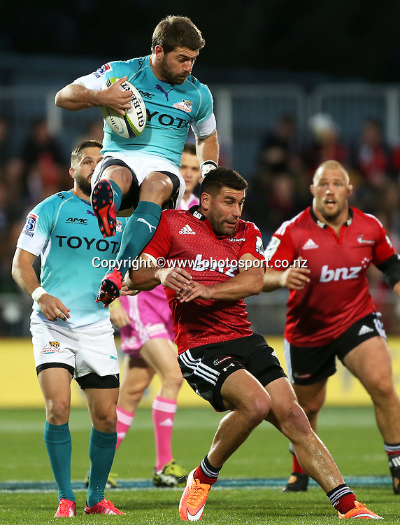 Kieron Fonotia of the Crusaders runs underneath Willie Le Roux of the Cheetahs during the Investec Super Rugby game between the Crusaders v Cheetahs at AMI Stadium in Christchurch. 21 March 2015 Photo: Joseph Johnson/www.photosport.co.nz