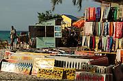 Africa. Tanzania. Zanzibar. Nungwi..Beach cloth and tinga tinga paintings forsale on the beach..CD0011