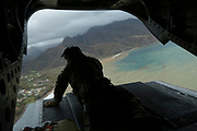 RAF Master of Aircrew, Vince Bartlett, looks out from the back of a Chinook helicopter during a needs assessment mission to the Island of Dominica following Hurricane Maria.<br /> <br /> Picture: Russell Watkins/DFID