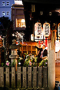 Throwing water on Buddha image at Hozenji Temple, Dotonburi/Minami area.