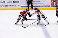 2019-12-01 | Umeå, Sweden: Teg (15) Josh Villaflorbattles for the puck with Kiruna (14) Andreas Kero in HockeyEttan during the game  between Teg and Kiruna at A3 Arena ( Photo by: Michael Lundström | Swe Press Photo )<br /> <br /> Keywords: Umeå, Hockey, HockeyEttan, A3 Arena, Teg, Kiruna, mltk19120