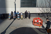 A group of Jehovah's Witnesses stand with their literature stands at Elephant & Castle, on 27th February 2019, in London, England.