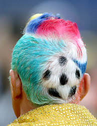 A Colombia fan sports a very detailed dyed hairstyle prior to the FIFA World Cup 2018, round of 16 match at the Spartak Stadium, Moscow.