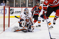 November 16, 2007; Newark, NJ, USA;  New York Islanders goalie Rick DiPietro (39) makes a save while New Jersey Devils right wing Brian Gionta (14) battles for the puck during the second period at the Prudential Center in Newark, NJ.
