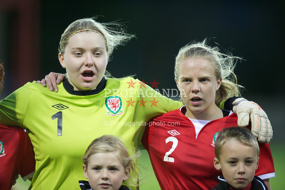 PORTHMADOG, WALES - Monday, October 1, 2012: Wales' goalkeeper Erin Brennan and captain Olivia Fuller sing the national anthem before the International Friendly Under-16's match against Belgium at y Traeth. (Pic by David Rawcliffe/Propaganda)