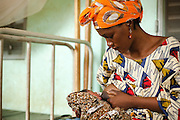 Mariam Keita, 20, breast feeds her newborn child at the Badegna community health center in the town of Kita, Mali on Sunday August 29, 2010.