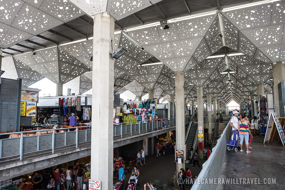 The distinctive semi-open roof of La Vega Central Market in downtown Chile, just across the Mapocho River from the Mercado Central. La Vega specializes in fruit, vegetables, and dairy goods as well as a number of eateries preparing Chilean cuisine.