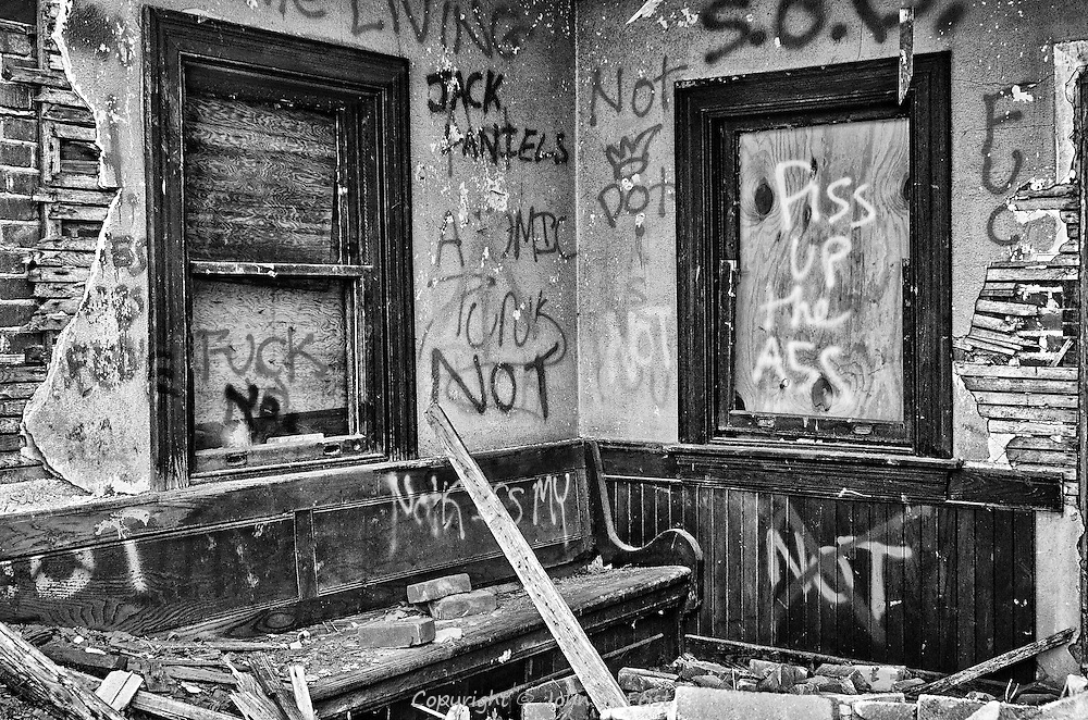 Part of the interior of the north bound waiting room in the abandoned Belle Mead station.  One of the brick walls has already started collapsing.  Yes some of the graffiti is harsh and angry, but it fits so well with the crumbling and destruction.