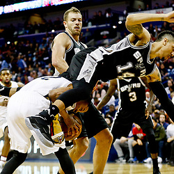 Mar 3, 2017; New Orleans, LA, USA; New Orleans Pelicans guard Tim Frazier (2) draws a foul from San Antonio Spurs guard Danny Green (14) during the second quarter of a game at the Smoothie King Center. Mandatory Credit: Derick E. Hingle-USA TODAY Sports
