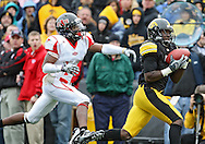 October 03, 2009: Iowa wide receiver Marvin McNutt (7) pulls in a 43 yard touchdown reception in front of Arkansas State defensive back Daylan Walker (13) during the second half of the Iowa Hawkeyes' 24-21 win over the Arkansas State Red Wolves at Kinnick Stadium in Iowa City, Iowa on October 03, 2009.
