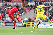 Swindon Town striker Jonathan Obika (9) shoots at goal during the EFL Sky Bet League 1 match between Swindon Town and AFC Wimbledon at the County Ground, Swindon, England on 14 April 2017. Photo by Stuart Butcher.