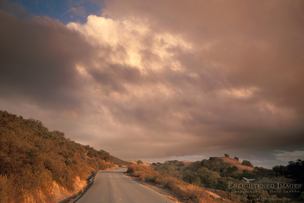 Cumulonimbus storm cloud at sunset over rural mountain road, Mount Diablo State Park, Contra Costa, California
