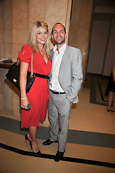 HOLLY WILLOUGHBY and husband DANIEL BALDWIN at the opeing of Green's Restaurant & Oyster Bar, 14 Cornhill, London EC3 on 1st September 2009.