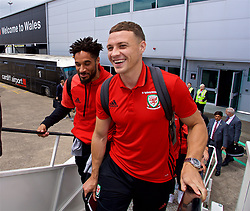 CARDIFF, WALES - Saturday, June 10, 2017: Wales' captain Ashley Williams and James Chester board the team plane as the squad depart Cardiff Tesla Airport to travel to Belgrade ahead of the 2018 FIFA World Cup Qualifying Group D match against Serbia. (Pic by David Rawcliffe/Propaganda)